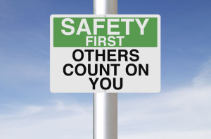 26223365 - a sign with a safety reminder